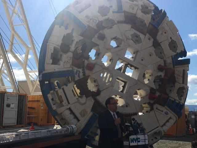 DEP Acting Commissioner Vincent Sapienza in front of cutter head of Nora, tunnel boring maching