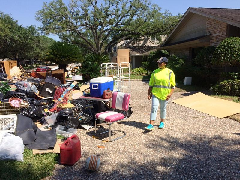 Rossana Coto-Batres surveys damage in one Houston neighborhood. WAMC listeners know Coto-Batres from her work with Capital Region complete Streets.