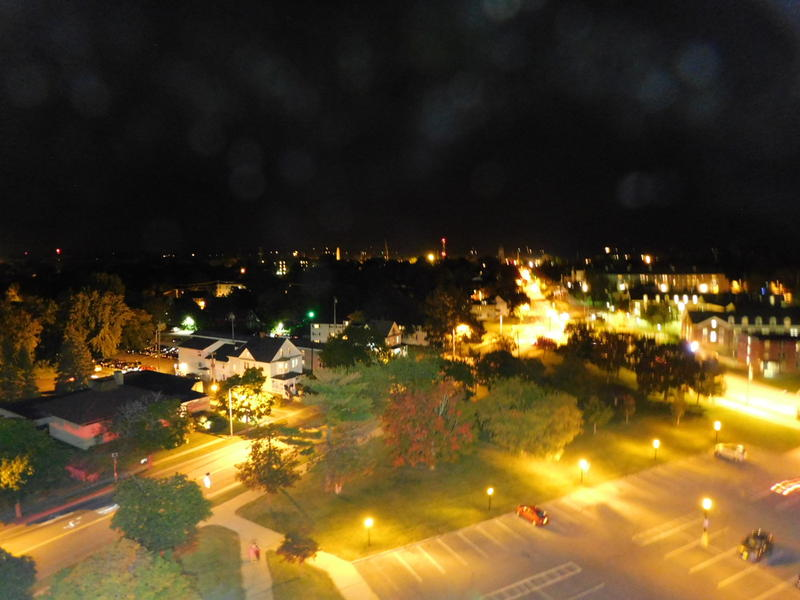 Night view of Plattsburgh and campus from the top of the ladder truck
