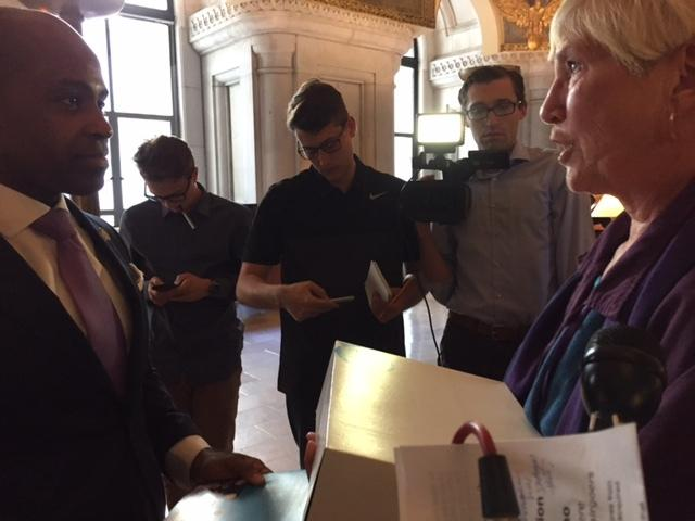 Aid-in-dying supporter Nancy Murphy tells her story to Governor Cuomo's counsel Alphonso David