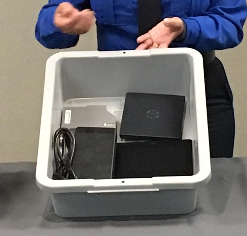 Examples of electronics that will need to be removed from carry-on bags for examination include tablets, kindle devices, games and cameras. They should be placed in a bin with nothing on top or underneath.