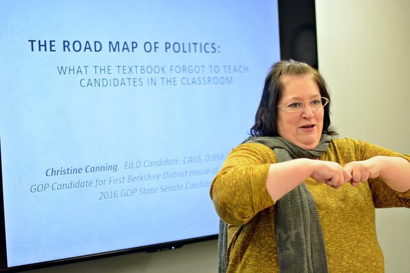 Republican Christine Canning encourages College Republicans  at the Massachusetts College of Liberal Arts to go into regional politics. Canning is gesturing how politicians clash once in a while.