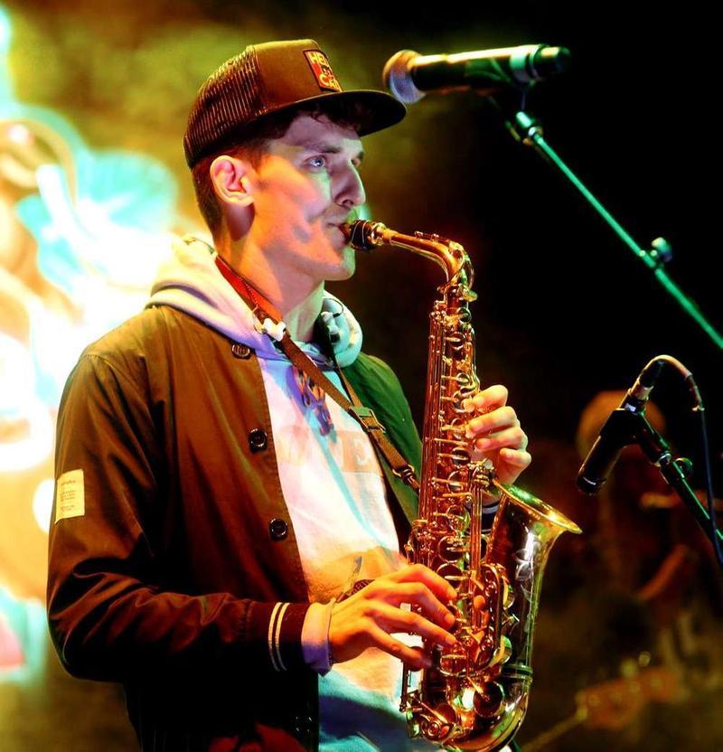 Grant Kwiecinski aka GRiZ playing the saxophone