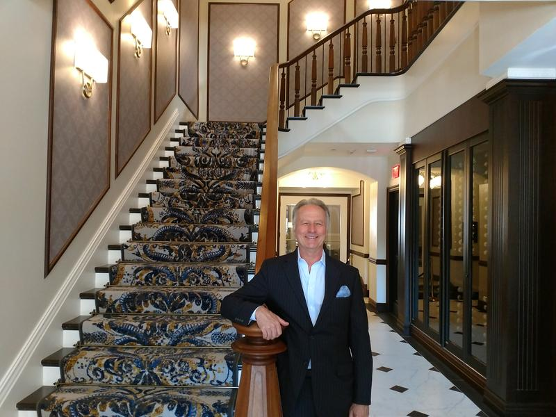 Adelphi Hotel COO Michel Ducamp beside the restored 1877 staircase