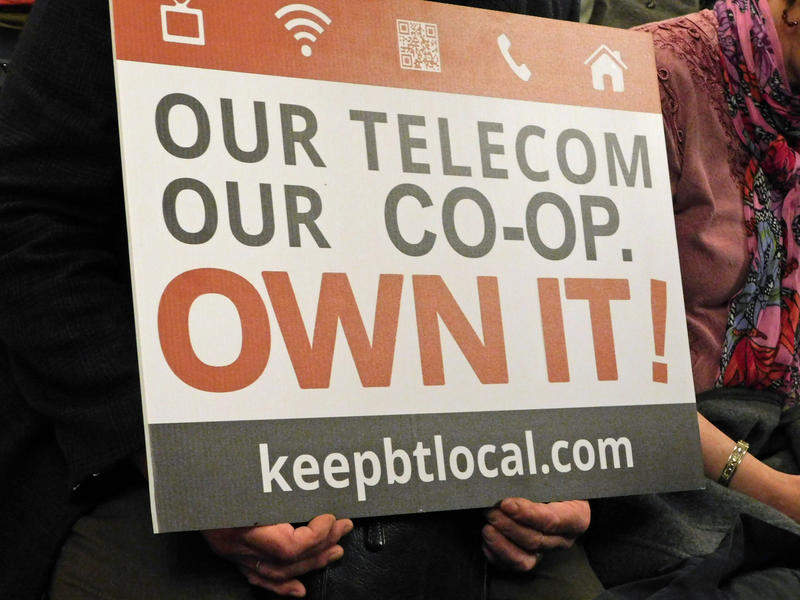 Keep Burlington Telecom Local supporter holding sign