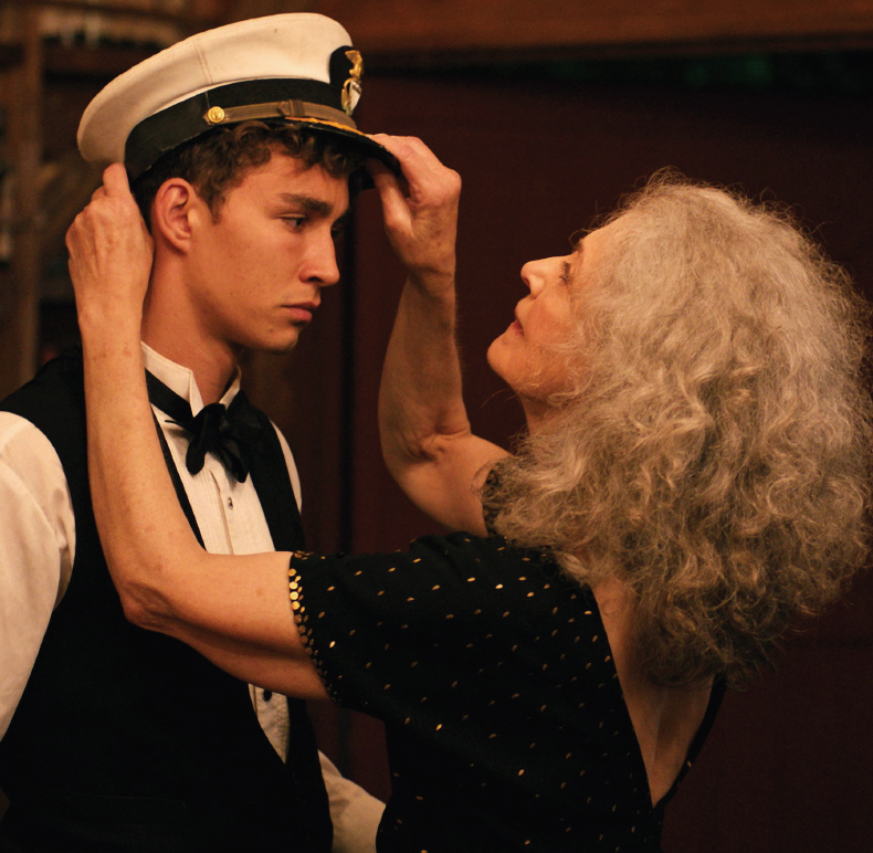 Robert Sheehan and Mary Beth Peil in The Song of Sway Lake