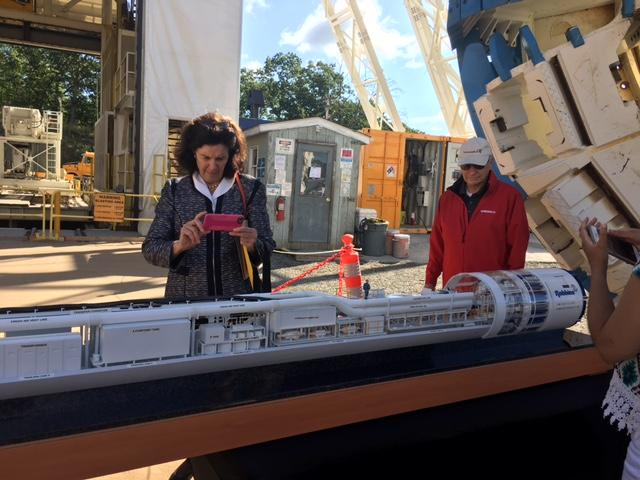 Coline Jenkins and John Abel look at tunnel boring machine (Nora) model