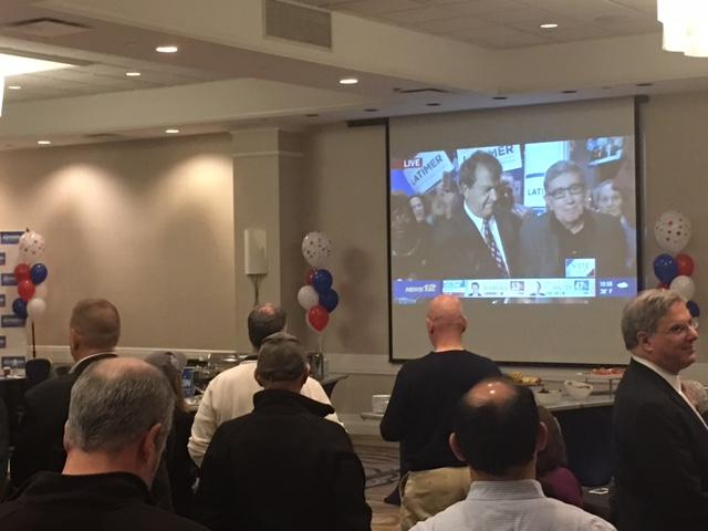 On the TV screen: Westchester County Executive-elect George Latimer (left) with former county exec Andrew Spano (right)