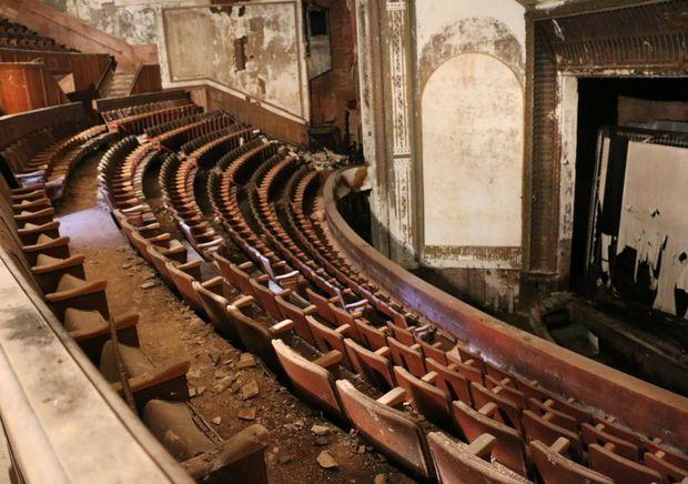 The Victory Theatre is said to be structurally sound, but inside it is a mess of crumbled plaster, warped and rotted wood, mold and mildue.