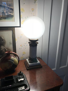 An antique lamp created by Myra and Ben Gardner