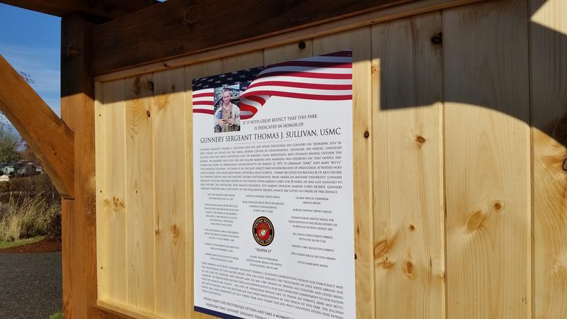 A poster tells the story of Gunnery Sgt. Thomas Sullivan and his ties to the East Forest Park neighborhood where the park bearing his name is located.