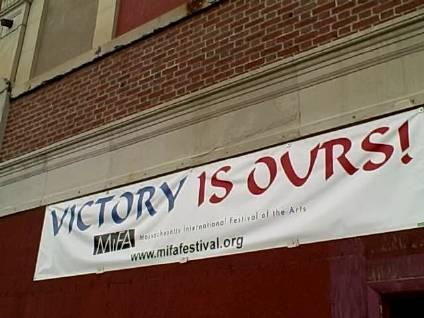 A banner on the Victory Theatre in Holyoke promotes the redevelopment project