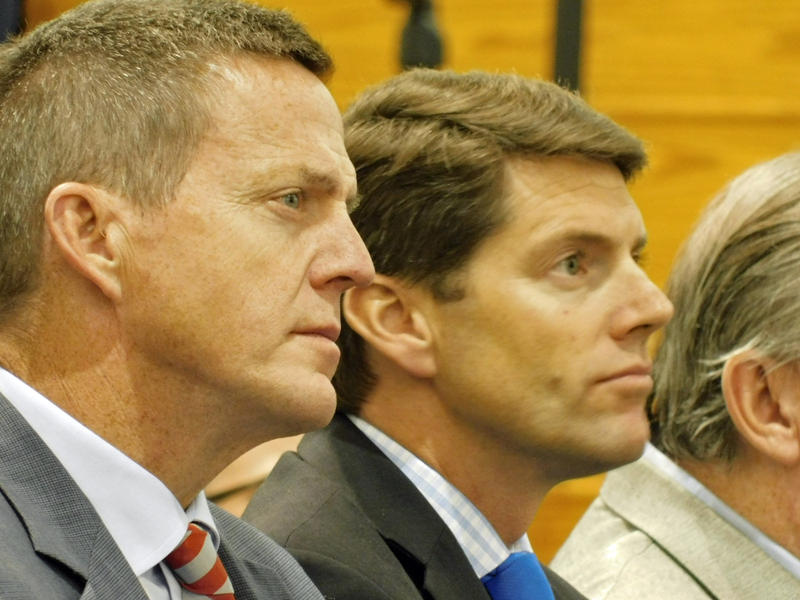 Clinton County District Attorney Andrew Wylie (left) and Assemblyman D. Billy Jones listen to Ryan Leaf
