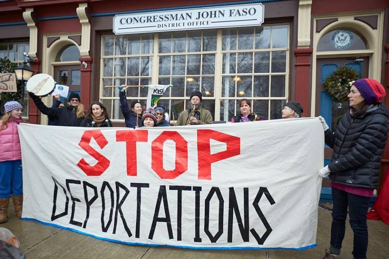 Activists rally outside Congressman John Faso's Kinderhook office.