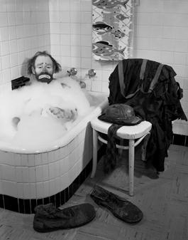 Emmett Kelly in a bubble bath, Sarasota, Florida