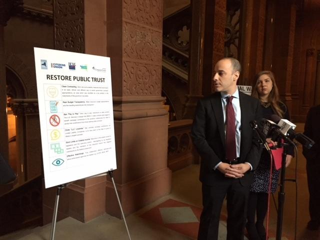 Alex Camarda, of Reinvent Albany, displays a chart listing potential reforms to clean up state government