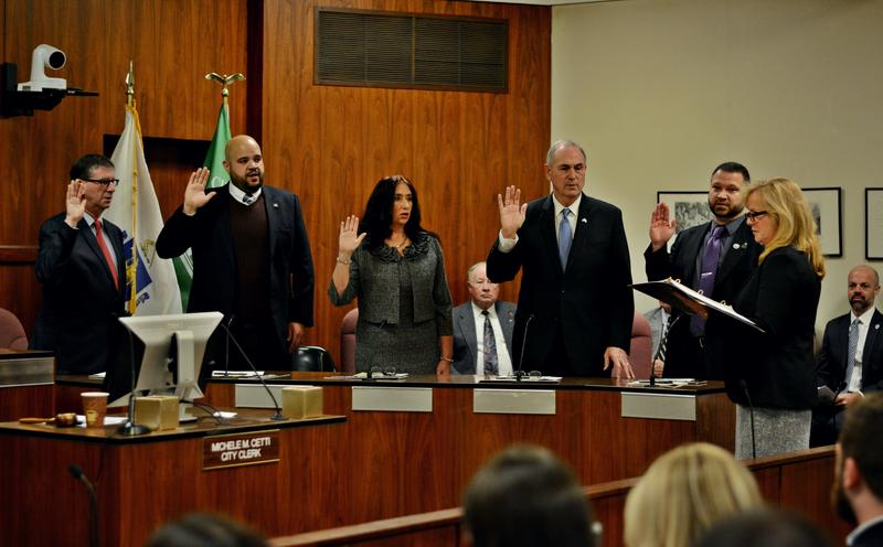 From left to right: Kevin Morandi, newly-elected councilor Earl Persip III, Donna Todd Rivers, Anthony Simonelli, Peter White and newly-elected city clerk Michele Cetti all took their oath in Pittsfield Tuesday before the seating arrangements were made.