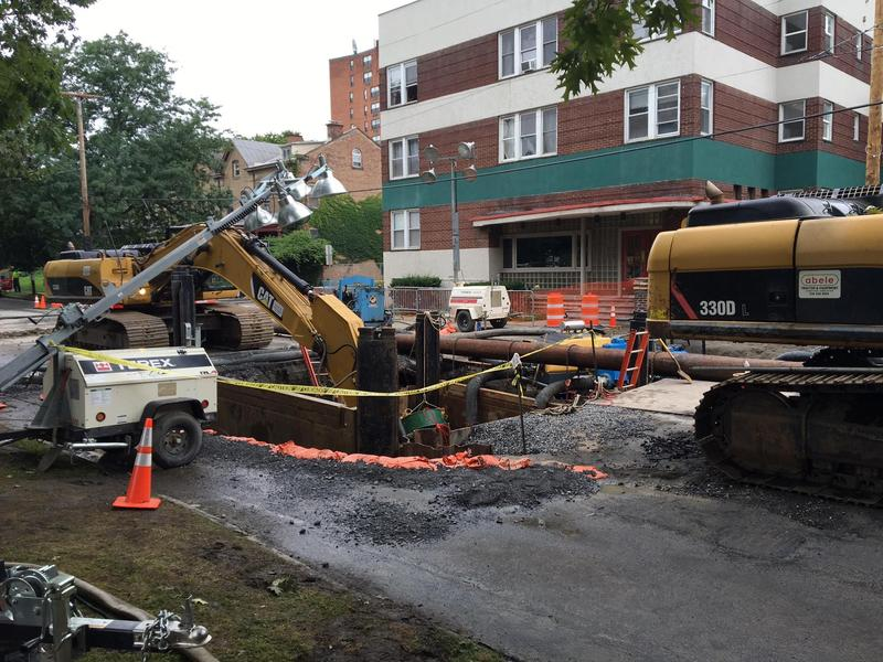 During the summer of 2016, crews work to repair a broken water main at the site of a sinkhole on South Lake Avenue at Elberon place in the city of Albany.