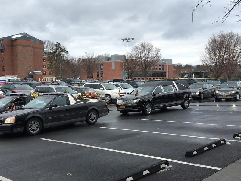 Funeral procession begins.