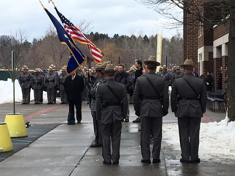 Troopers and other law enforcement officers assemble outside Siena College following services for Michael Anson.