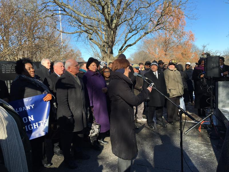 Bundled up against the harsh January cold, Albany Mayor Kathy Sheehan is joiined by community members and government officials in observance of MLK Day.