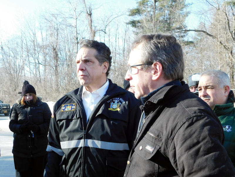 Plattsburgh Mayor Colin Read (right) leads Governor Andrew Cuomo (center) on tour of flood damaged Underwood Mobile Home Park