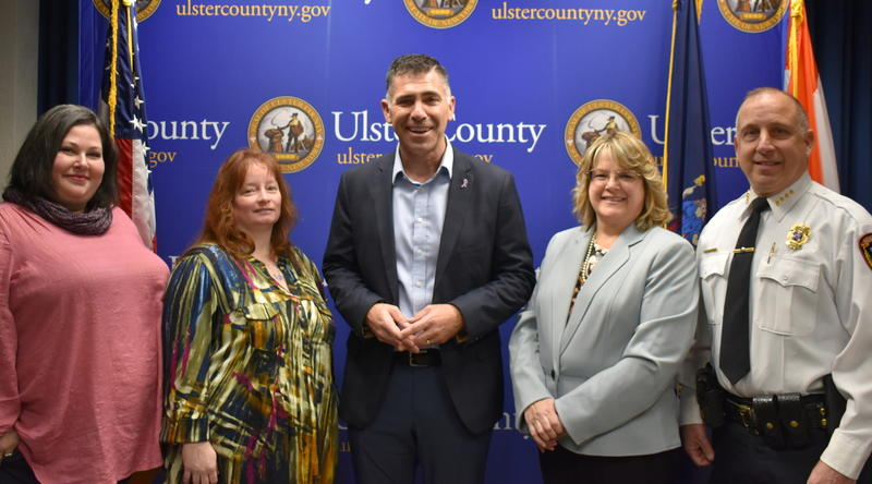 Sarah Kramer-Harrison and Cindi Craft of Ulster County Crime Victims Assistance Program; County Executive Mike Hein; Nancy Schmidt, Deputy Director of Ulster County Department of  Probation; and Town of New Paltz Police Chief Joseph Snyder