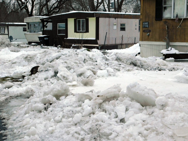 Ice surrounds flooded homes at Underwood Mobile Home Park