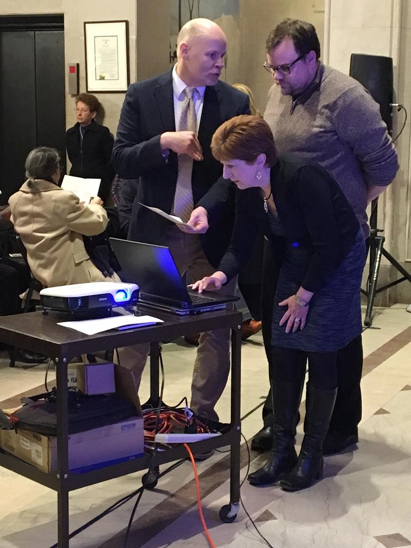 Albany Mayor Kathy Sheehan does a last-minute check of equipment before the Kennedy Celebration begins.