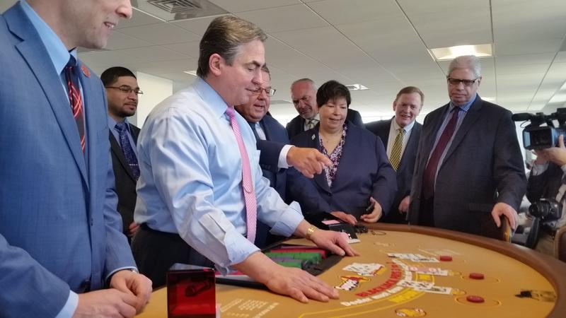 For the media preview of the gaming school, Springfield Mayor Domenic Sarno was given a lesson in dealing blackjack