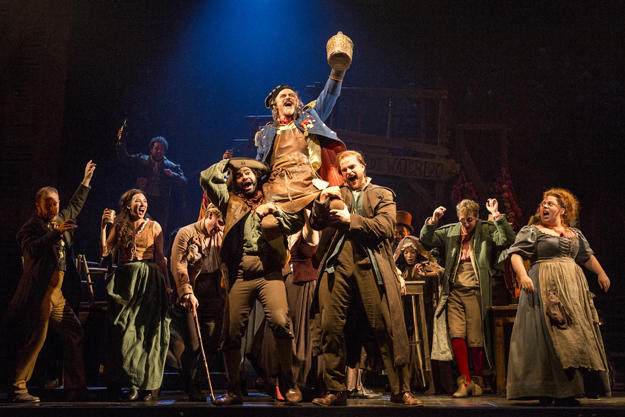 "The company of LES MISÉRABLES performs ""Master of the House"" with J Anthony Crane as 'Thénardier' and Allison Guinn as 'Madame Thénardier.'"