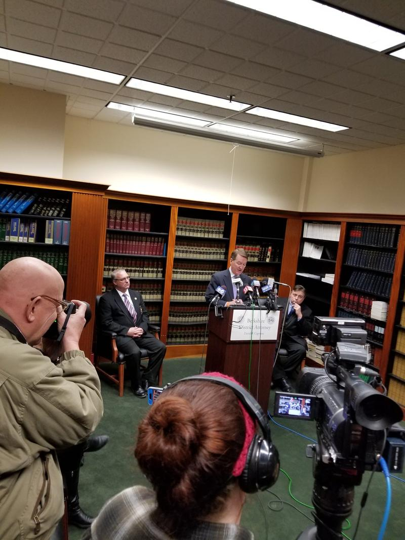 David Capeless announcing his retirement at a March 1st press briefing; Paul Caccaviello, seated right, looks on.