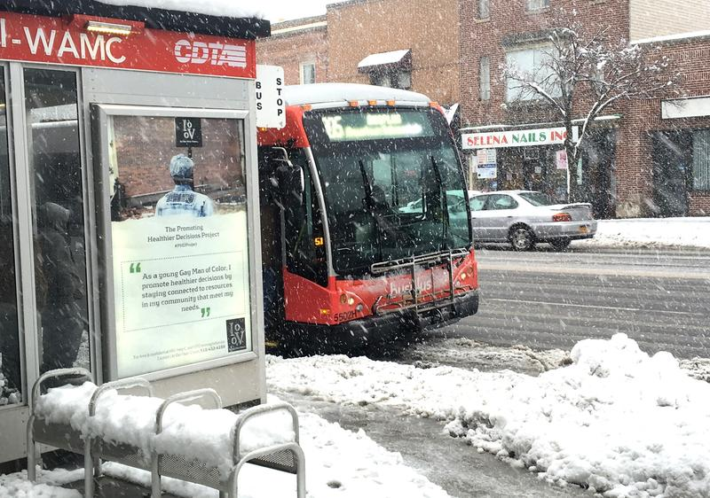 A CDTA bus picks up passengers outside the WAMC studios on Albany's Central Avenue.
