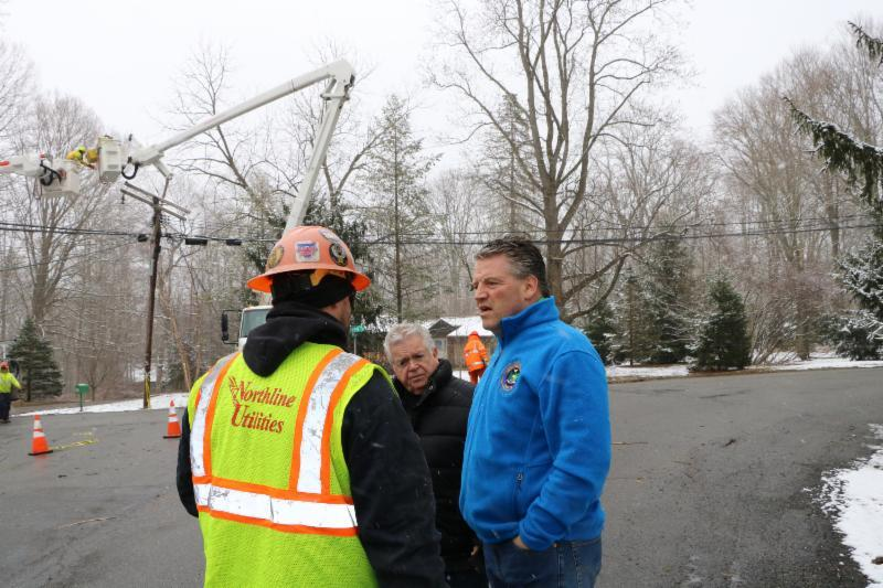 Senator Terrence Murphy (right) and Somers Supervisor Rick Morrissey are briefed on restoration efforts by a crew worker from Northline Utilities in Somers.