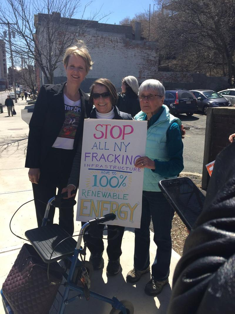 Candidate for New York governor Cynthia Nixon poses with supporters at an Earth Day rally against Governor Andrew Cuomo's energy policies outside the state Capitol in Albany Monday.
