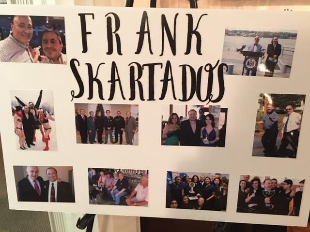 Pictures on an easel during viewing hours for Frank Skartados
