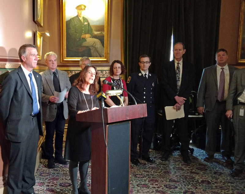 Governor Phil Scott (left) joins Drug Prevention Policy Director Jolinda LaClair (at podium) and others at Vermont's Opioid Awareness Day