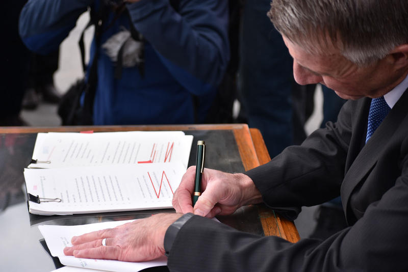 Governor Phil Scott signs gun bills into law