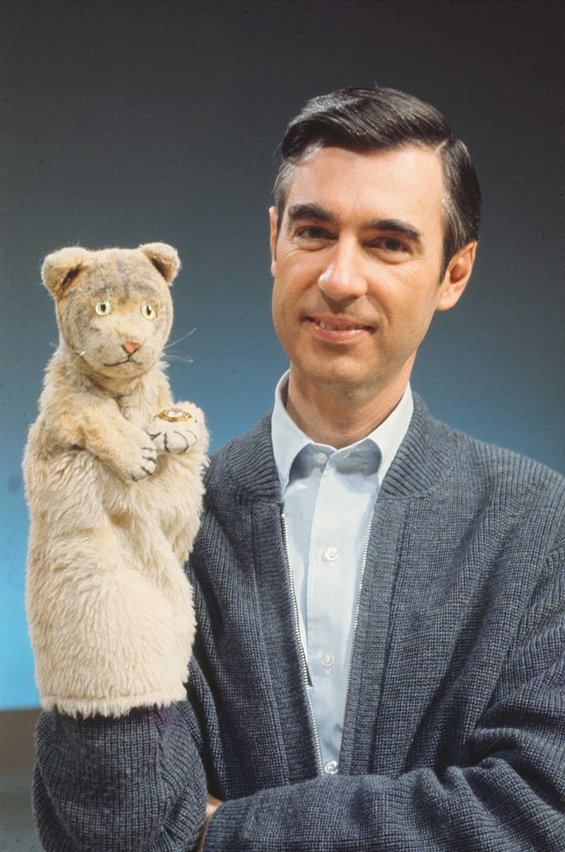 Fred Rogers poses with Daniel Striped Tiger.