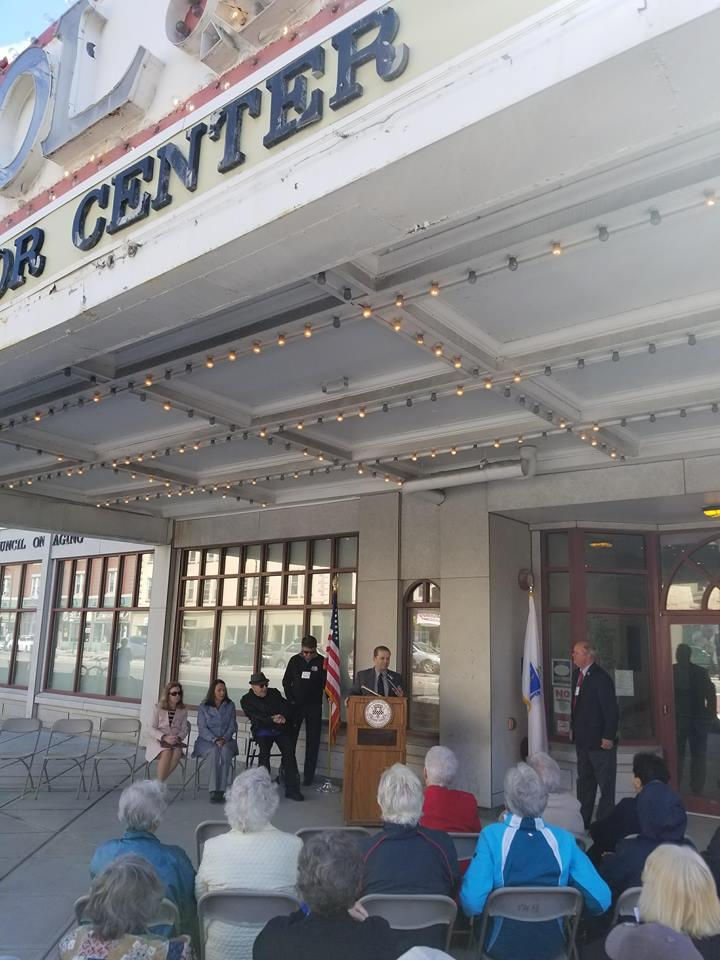 Vin Marinaro addresses attendees of the Ralph J. Froio Senior Center 25th Anniversary ribbon cutting ceremony for the restoration of the building's iconic marquee on May 1st, 2018.