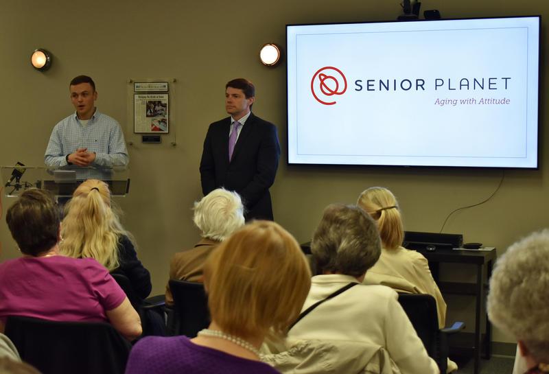Alex Glazebrook (left) and Assemblyman D. Billy Jones talk about the Senior Planet program in Plattsburgh
