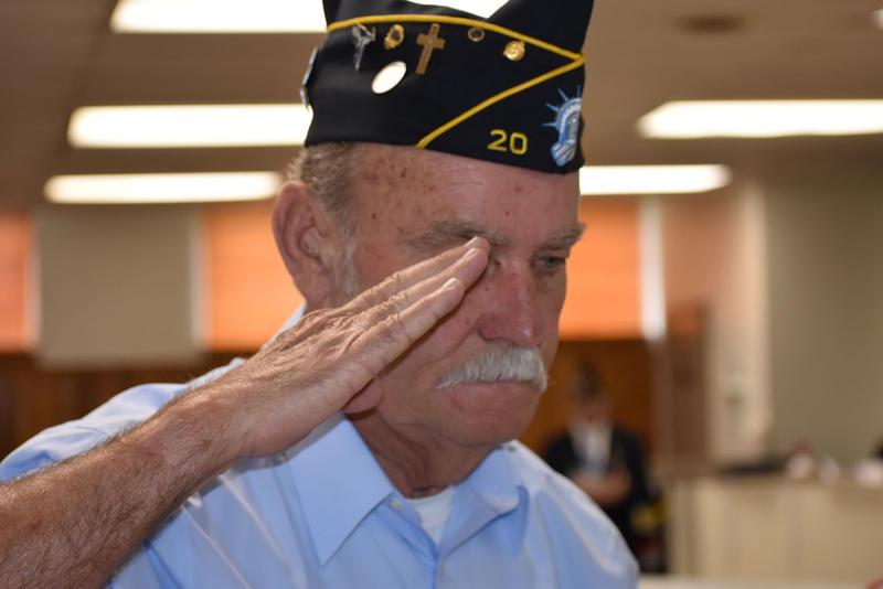 Jim Page lays a Disabled American Veterans wreath in memory of Paul Dumas
