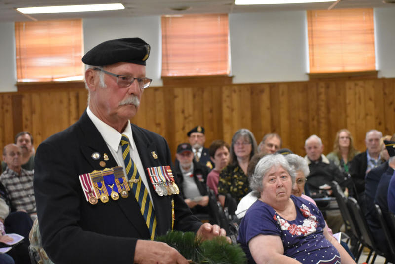 Karl Kramell lays a wreath for Canadian Legion Post 244