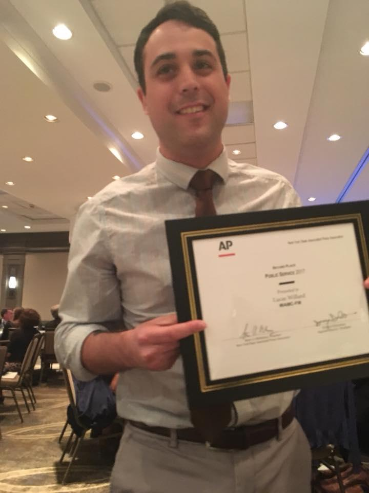WAMC's Southern Adirondack Bureau Chief Lucas Willard with a second place award for Public Service