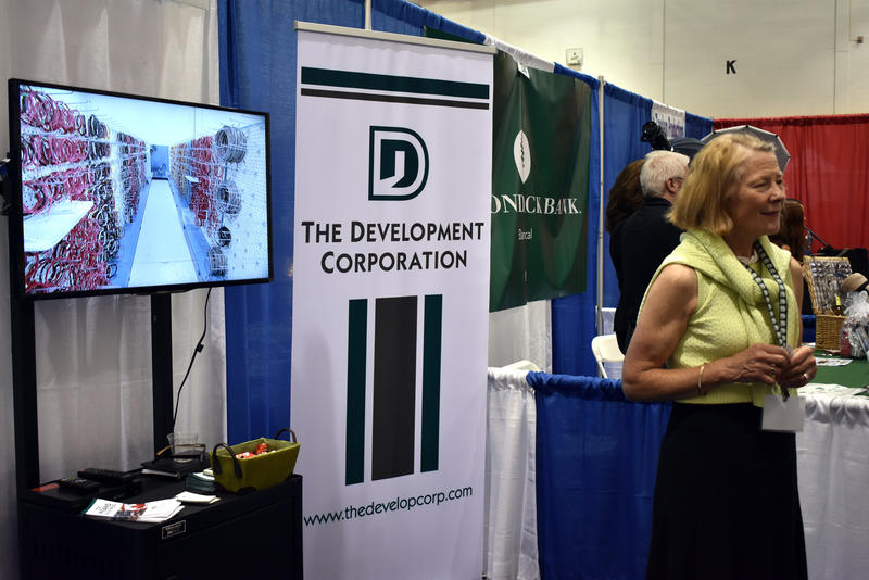 Joanne Dahlen at The Development Corporation booth during the Business Expo