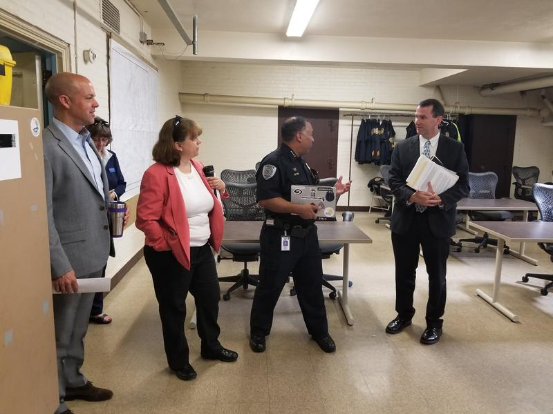 State Senator Adam Hinds, State Representative Tricia Farley-Bouvier, Pittsfield Police Chief Michael Wynn, and Jim Cantwell, the Massachusetts State Director for U.S. Senator Ed Markey, at the Pittsfield Police Station