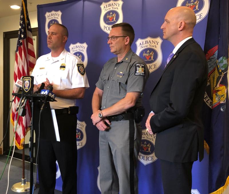 Albany's Acting Police Chief Robert Sears, left, speaking to reporters Thursday