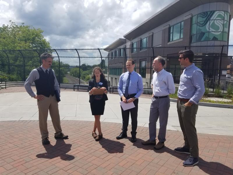 Michael Canales of North Adams, Ariel Moyal and Ben Hellerstein of Environment Massachusetts, James Kolesar of Williams College, and Tory Hanna of Origin Solar Energy in downtown Pittsfield's Persip Park.