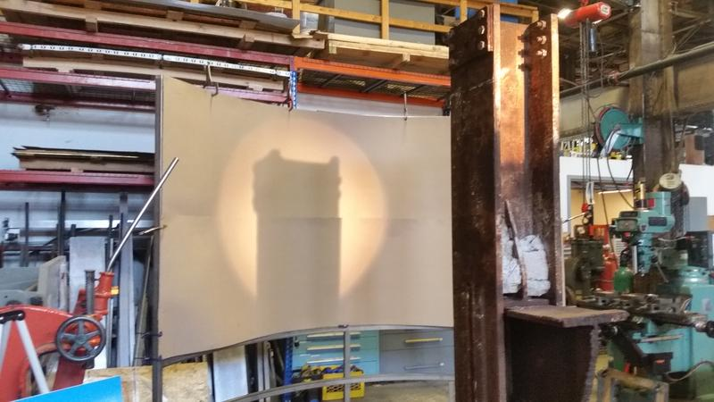 An artificat from the World Trade Center is used to cast a shadow reminiscent of one of the Twin Towers on a curved wall. The 9/11 memorial is being fashioned at Salmon Studios in Florence, Massachusetts