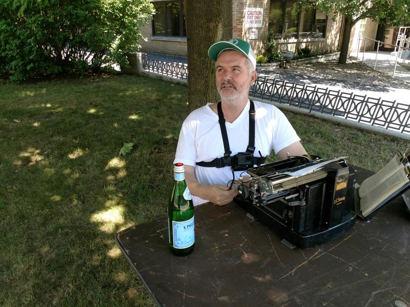 Artist Tim Youd at his typewriter